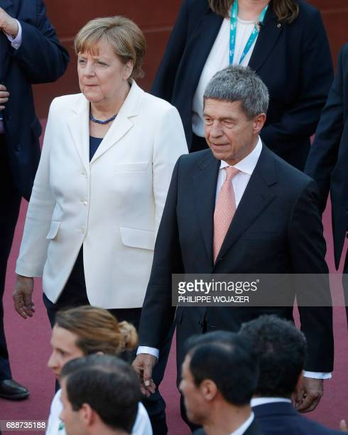 German Chacellor Angela Merkel and her husband Joachim Sauer arrive to attend a concert of the La Scala Philharmonic Orchestra during the Summit of...