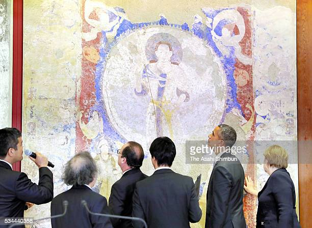 German Chanceller Angela Merkel US President Barack Obama and French President Francois Hollande watch the reproduced mural of the Bamiyan which was...