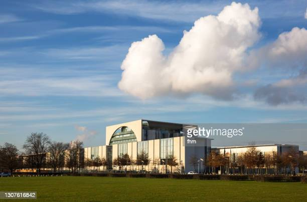 german chancellery and a large cloud (berlin, germany) - german chancellery stock pictures, royalty-free photos & images