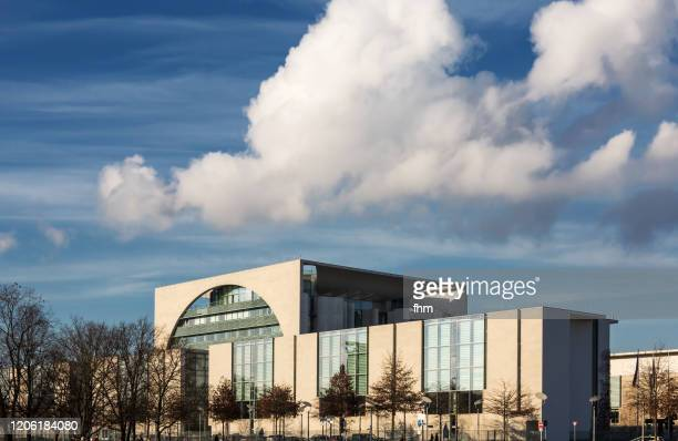 german chancellery with clouds (berlin, germany) - prime minister stock pictures, royalty-free photos & images