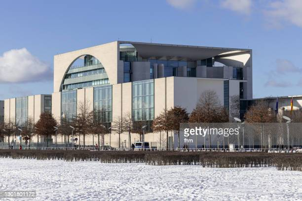 german chancellery with snow (berlin, germany) - german chancellery stock pictures, royalty-free photos & images