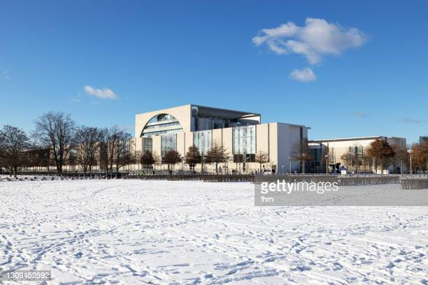 german chancellery with snow(berlin, germany) - german chancellery stock pictures, royalty-free photos & images