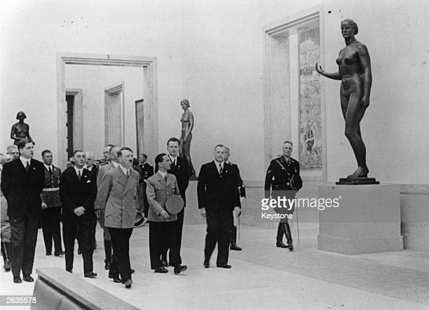 German chancellor Adolf Hitler accompanied by Joseph Goebbels at the 1938 Nazi Art Exhibition during the 'Day of German Art' celebrations at Munich...
