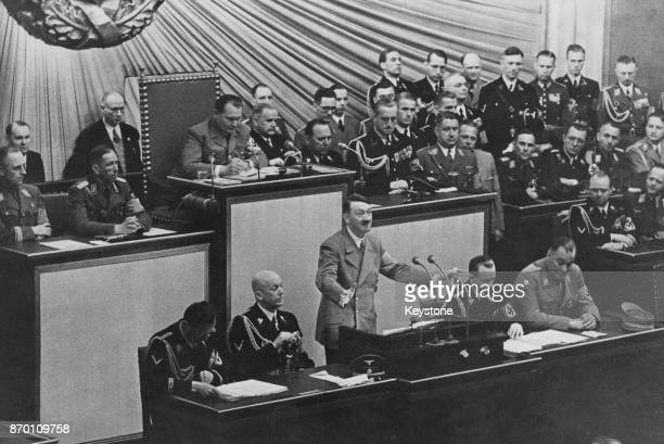 German Chancellor Adolf Hitler addresses the Reichstag in Berlin, Germany, 1939. Also pictured are Hermann Goering, Otto Dietrich, Wilhelm Brückner,...