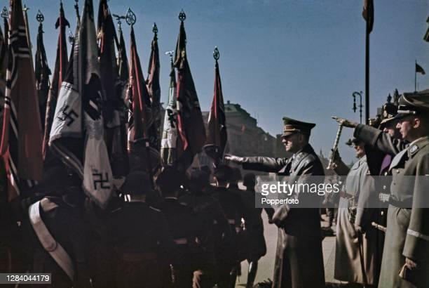 German Chancellor Adolf Hitler along with senior Nazi Party military chiefs Reichsmarschall Herman Goering , Admiral Karl Doenitz and Reichsfuhrer...