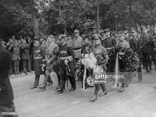German Chancellor Adolf Hitler and Admiral Erich Raeder attend the funeral of Prussian officer Ludwig von Schröder in Berlin Germany 26th July 1933...