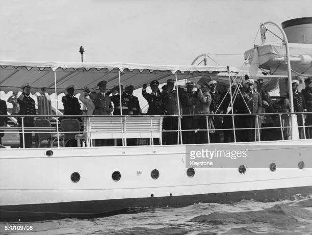 German Chancellor Adolf Hitler and Admiral Erich Raeder CommanderinChief of the German Navy on the steamer 'Nixe' during the Olympic yachting...