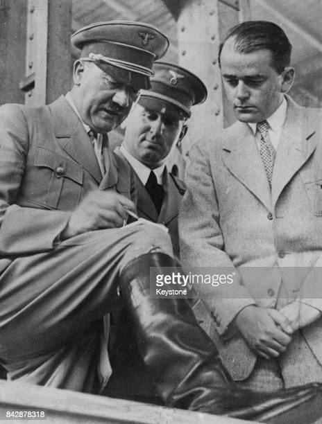 German Chancellor Adolf Hitler and architect Albert Speer go through the arrangements at Nuremberg Germany before the Reichsparteitag or Nuremberg...