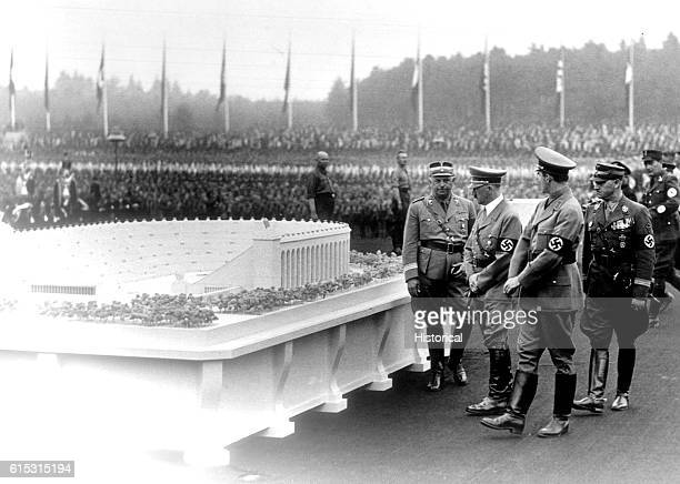 German Chancellor Adolf Hitler and architect Albert Speer inspect Speer's model for a huge stadium to be built at Nuremberg