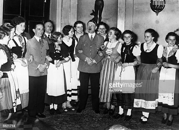 German chancellor Adolf Hitler and German Nazi politician Joseph Goebbels surrounded by women from the Rhineland in national costume