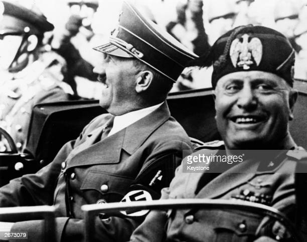 German chancellor Adolf Hitler and Italian dictator Benito Mussolini in jovial mood during a drive through the streets of Florence Italy