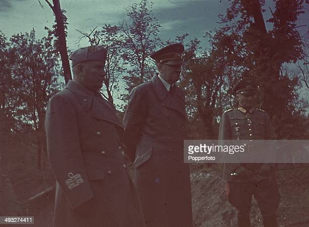 German Chancellor Adolf Hitler and Italian Prime Minister Benito Mussolini meet during a visit to the Eastern front in August 1941.
