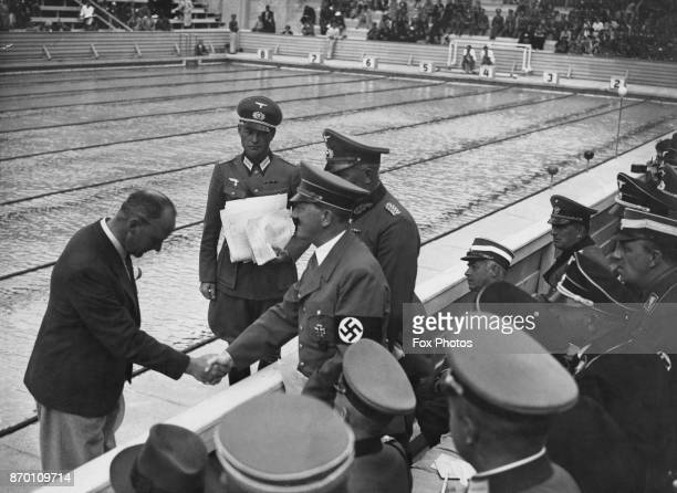 German Chancellor Adolf Hitler at a swimming event during the Berlin Olympics Germany August 1936