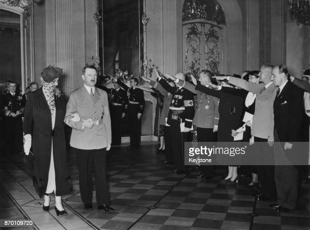 German Chancellor Adolf Hitler escorts Madame Horthy the wife of Hungarian Admiral and Regent Miklos Horthy to breakfast at the Charlottenburg Palace...