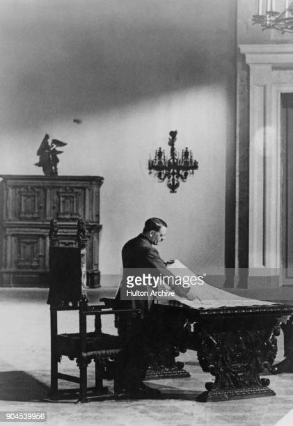 German Chancellor Adolf Hitler examines maps at Berchtesgaden in the Bavarian Alps Germany circa 1940