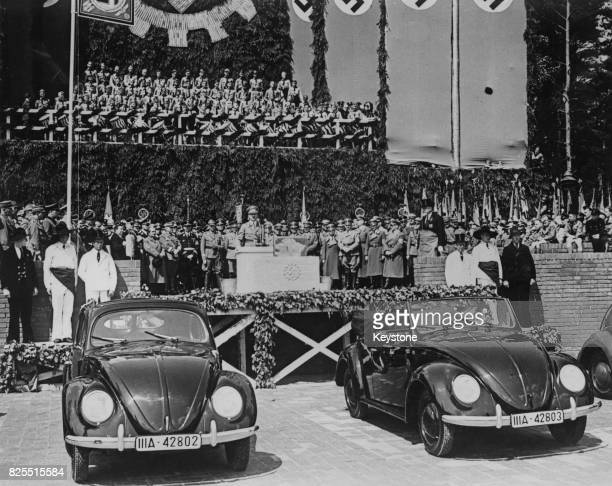 German Chancellor Adolf Hitler gives a speech after laying the foundation stone of the new Volkswagen works at Fallersleben 27th May 1938 In front...