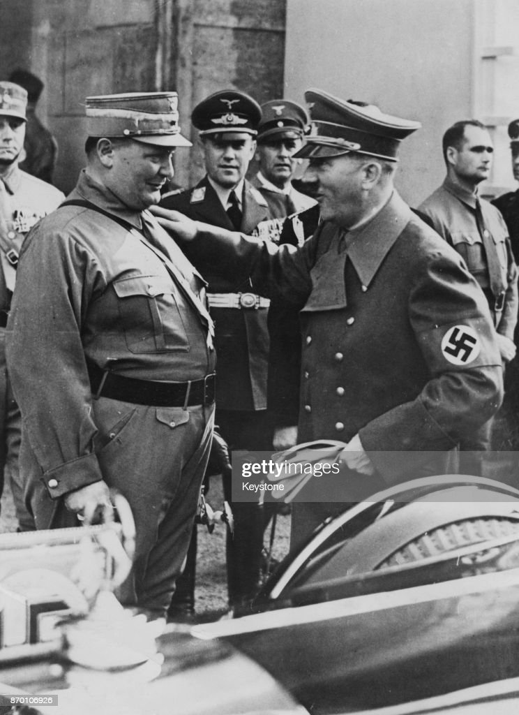 German Chancellor Adolf Hitler (1889 - 1945) gives Hermann Goering (1893 - 1946), President of the Reichstag, a friendly pat on the shoulder during a view of troops at Luitpold Arena in Nuremberg, Germany, 11th September 1938. Rudolf Hess can be seen on the right.