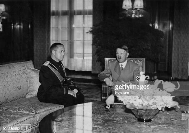 German Chancellor Adolf Hitler in the new Reich Chancellery in Berlin Germany with Count Galeazzo Ciano the Italian Foreign Minister after signing...