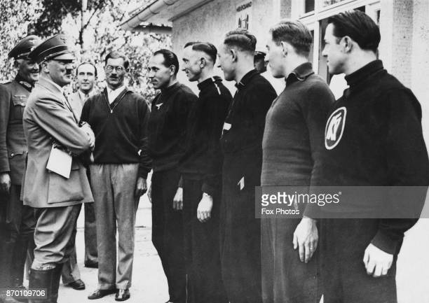 German Chancellor Adolf Hitler meets a group of sprinters at the Olympic Village during the Berlin Olympics Germany 1936