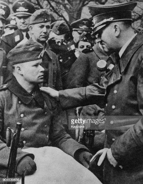 German Chancellor Adolf Hitler meets a wounded soldier during Operation Barbarossa the Axis invasion of the Soviet Union during World War II 1941