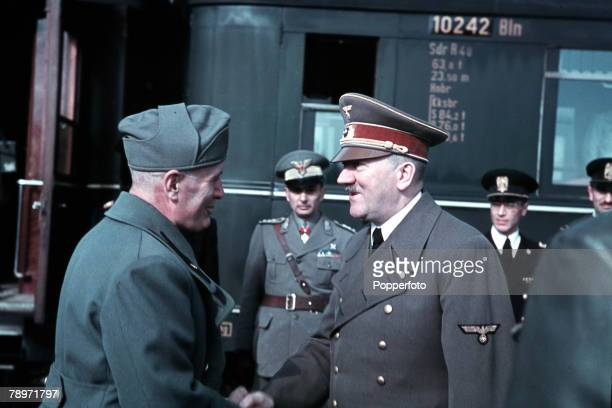 German Chancellor Adolf Hitler meets with Italian Prime Minister Benito Mussolini and Axis officers at a railway station in Florence Italy during...