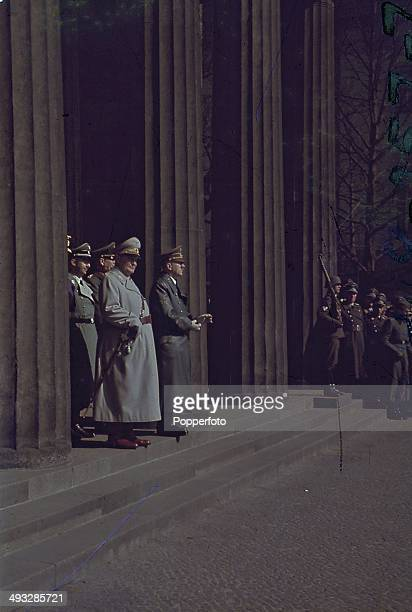 German Chancellor Adolf Hitler pictured with Aviation Minister Hermann Goering Heinrich Himmler and other Commanders on the steps of a Reich building...