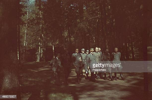 German Chancellor Adolf Hitler pictured with Chief of Staff Alfred Jodl and other high ranking officials in the grounds of the Wolf's Lair...