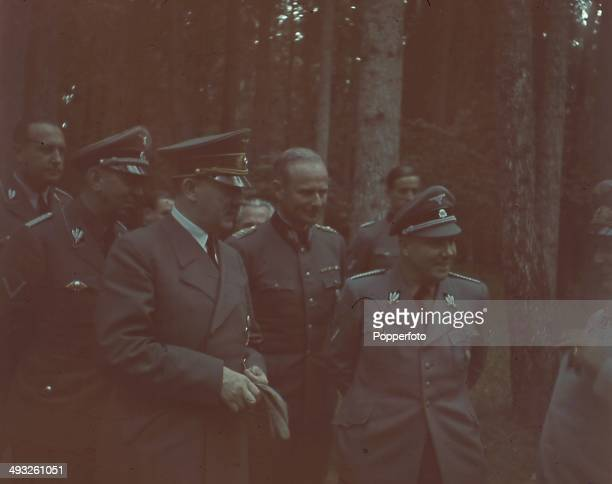 German Chancellor Adolf Hitler pictured with various Generals and high ranking officials including Hermann Goering on far right in the forest of...