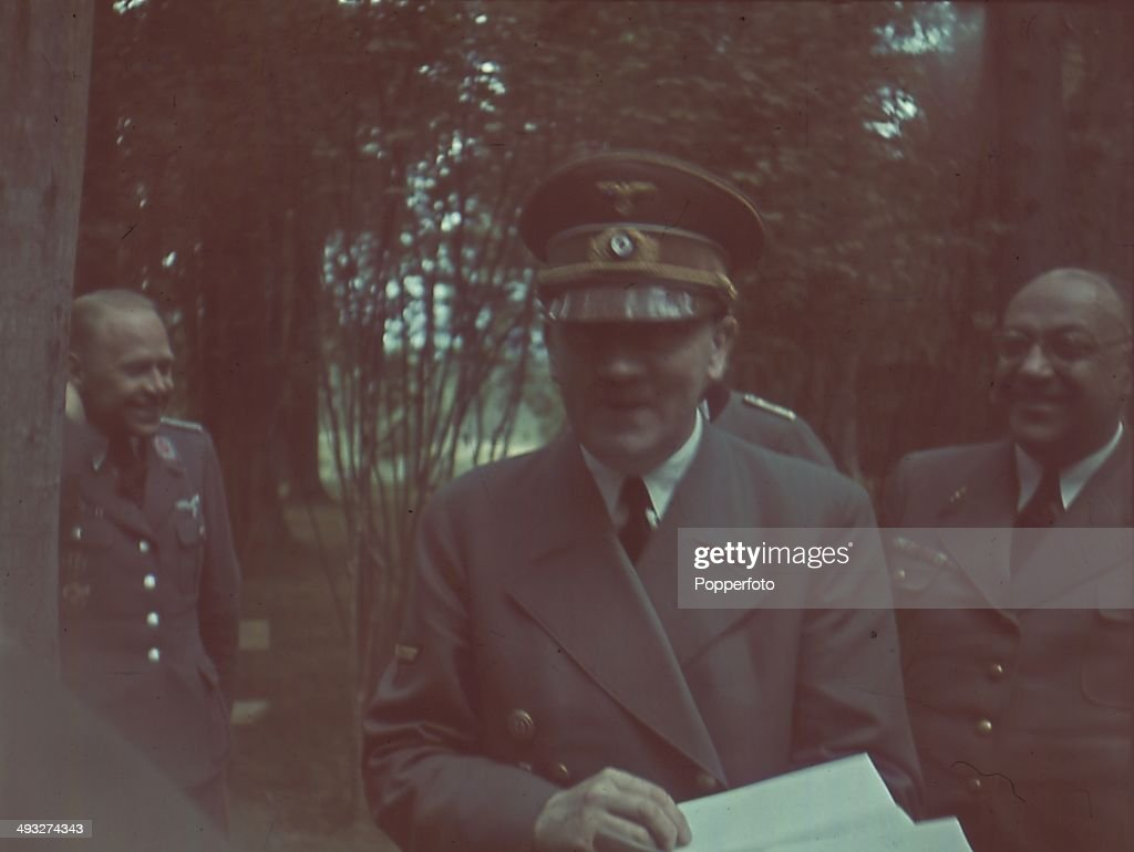 German Chancellor Adolf Hitler reads official papers with