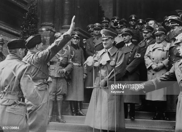 German Chancellor Adolf Hitler receives messages of allegiance from all 31 German provinces on the steps of the Town Hall in Vienna, Austria, on the...