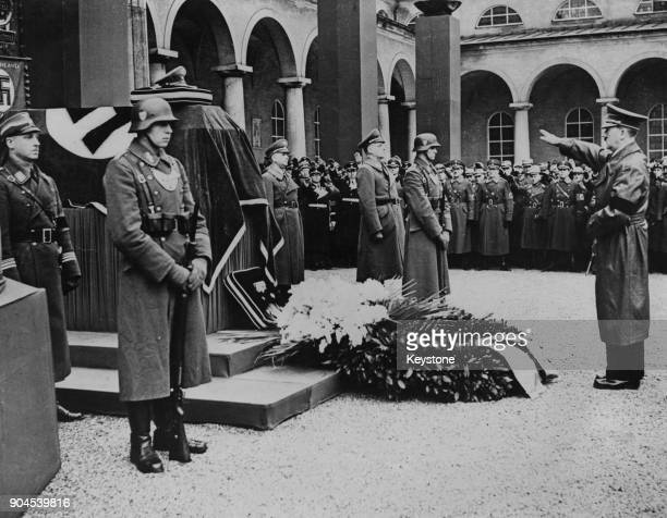 German Chancellor Adolf Hitler salutes the coffin of Gerhard Wagner at the state funeral of the Reich Doctor's Leader in Munich Germany 27th March...