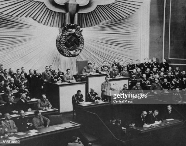 German Chancellor Adolf Hitler speaks at the Reichstag in Berlin, Germany, 1939. Also pictured are Rudolf Hess, Joseph Goebbels, Hermann Goering,...