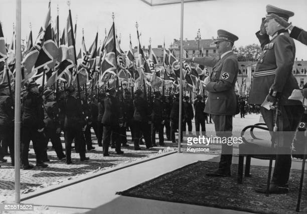 German Chancellor Adolf Hitler takes the salute during a parade of ex-servicemen in Kassel, Germany, 4th June 1939.