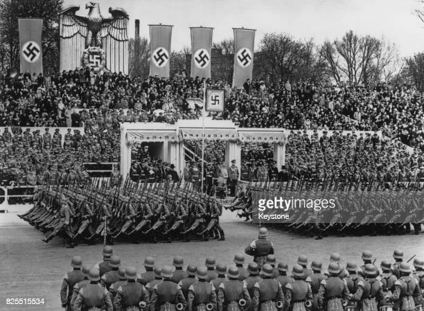 German Chancellor Adolf Hitler takes the salute from members of the German Infantry during a 50000 man parade in Berlin to celebrate his birthday...