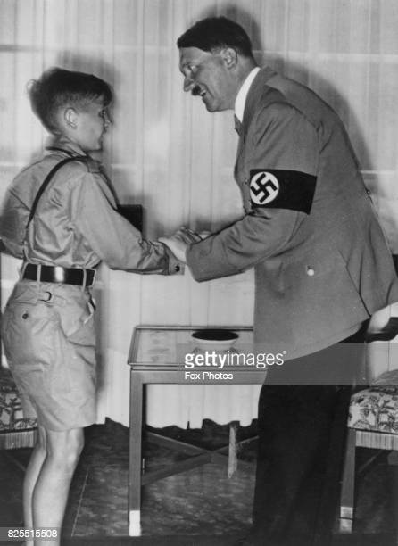 German Chancellor Adolf Hitler talking to a young boy circa 1939