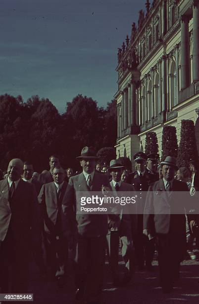 German Chancellor Adolf Hitler walks with Robert Ley Joseph Goebbels and Martin Bormann along with other senior figures circa 1935