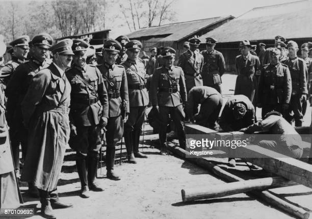 German Chancellor Adolf Hitler watches men at work in a military camp at St Polten near Vienna, during a tour of Austria, April 1939.
