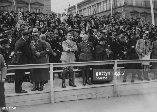 German Chancellor Adolf Hitler watches the festival procession after laying the foundation stone of the Haus der Deutschen Kunst in Munich Germany...