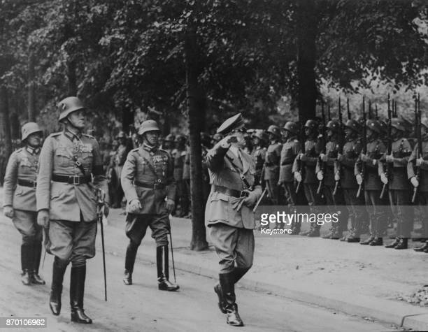 German Chancellor Adolf Hitler with German Defence Minister and General Werner von Blomberg during a military inspection 6th August 1934