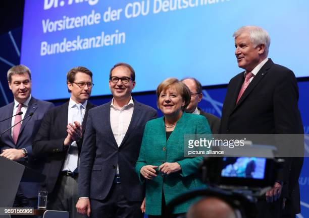German chancellor and CDU Chairwoman Angela Merkel arrives at the CSU's party congress with Bavarian Minister of Finance Markus Soder CSU Secretary...