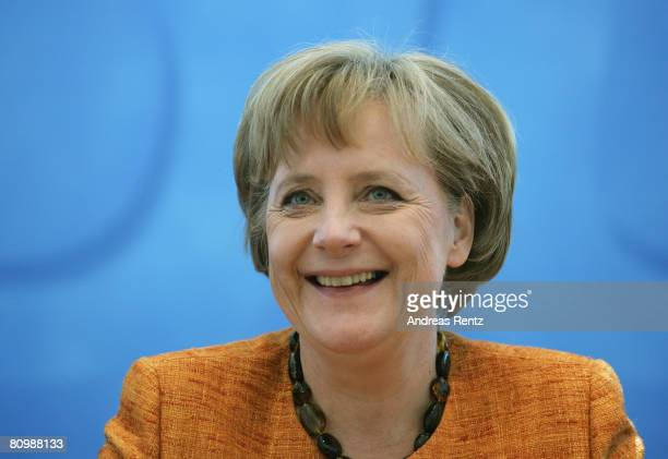 German Chancellor and Chairman of the Christian Democratic Union Angela Merkel smiles prior to the weekly CDU board meeting at the...