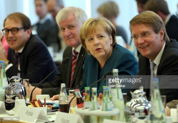 German Chancellor and Chairwoman of German Christian Democrats Angela Merkel and Chairman of the Bavarian Christian Democrats Horst Seehofer sit down...