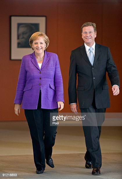 German Chancellor and Chairwoman of the Christian Democratic Union political party Angela Merkel and Guido Westerwelle party leader of the Free...