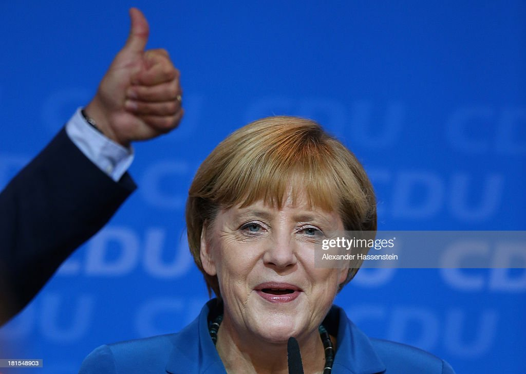 German Chancellor and Chairwoman of the German Christian Democrats (CDU) Angela Merkel, speaks to supporters at CDU headquarter Konrad-Adenauer-Haus after initial results give the CDU 42% of votes cast in the Germany election on September 22, 2013 in Berlin, Germany.