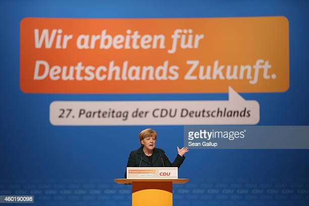 German Chancellor and Chairwoman of the German Christian Democrats Angela Merkel speaks to delegates at the annual CDU party congress on December 9...