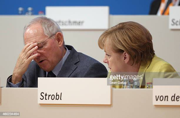 German Chancellor and Chairwoman of the German Christian Democrats Angela Merkel and German Finance Minister Wolfgang Schaeuble chat at the annual...