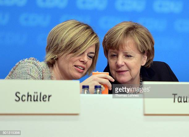 German Chancellor and Chairwoman of the German Christian Democrats Angela Merkel looks at the mobile phone of the deputy chairwoman of CDU party...