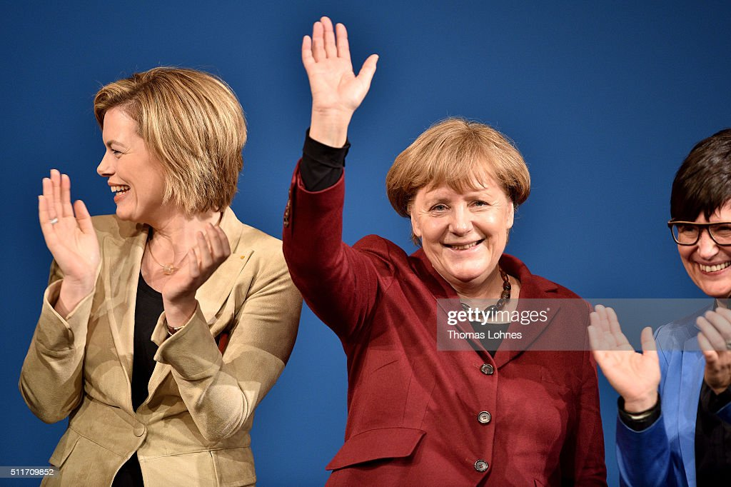 German Chancellor and Chairwoman of the German Christian Democrats (CDU) Angela Merkel (C) and CDU lead candidate for Rhineland-Palatinate Julia Kloeckner (L) greet supporters at an election campaign rally on February 22, 2016 in Landau in der Pfalz, Germany. State elections scheduled for March 13 in three German states: Rhineland-Palatinate, Saxony-Anhalt and Baden-Wuerttemberg, will be a crucial test-case for German Chancellor and Chairwoman of the German Christian Democrats (CDU) Angela Merkel, who has come under increasing pressure over her liberal immigration policy towards migrants and refugees. The right-wing Alternative fuer Deutschland (AfD), with campaign rhetoric aimed at Germans who are uneasy with so many newcomers, has solid polling numbers and will almost certainly win seats in all three state parliaments.