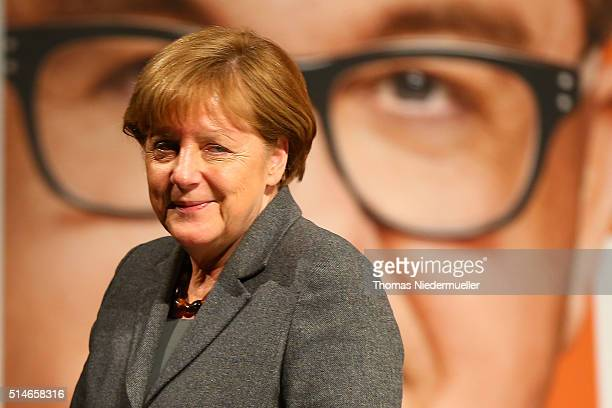 German Chancellor and Chairwoman of the German Christian Democrats Angela Merkel speaks to supporters at a CDU campaign rally ahead of...