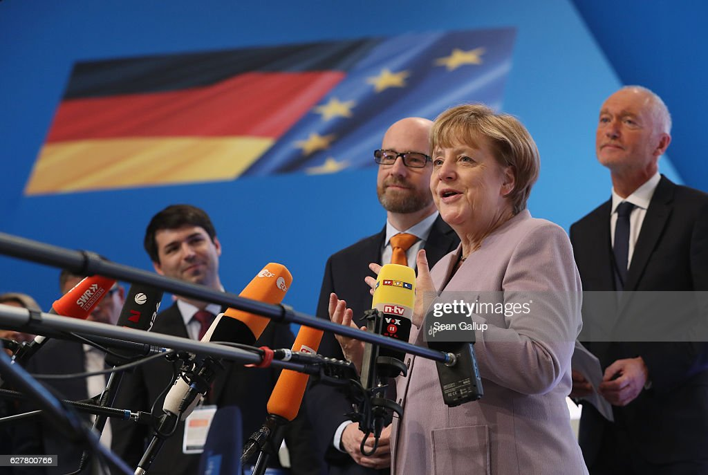 German Chancellor and Chairwoman of the German Christian Democrats (CDU) Angela Merkel speaks to journalists while viewing the hall where the CDU will hold its annual federal congress beginning tomorrow on December 5, 2016 in Essen, Germany. Over 1,000 CDU delegates will meet to debate and vote on the party's course for next year following the recent announcement by Merkel that she will run for a fourth term as chancellor in federal elections scheduled for next September.